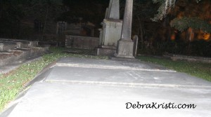 Tombstones at night in Journey to the Madewood Post by Debra Kristi, Author